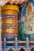Trongsa, Bhutan.  A Prayer Wheel and Religious Painting  in The Trongsa Dzong (Monastery-Fortress).