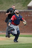 NJIT Highlanders catcher Edgar Badaraco (28) chases after a pop fly during game two of a double-header against the High Point Panthers at Williard Stadium on February 18, 2017 in High Point, North Carolina.  The Highlanders defeated the Panthers 4-2.  (Brian Westerholt/Four Seam Images)