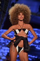 MIAMI BEACH, FL - JULY 12: Models back stage and walking the runway for the Baes and Bikinis show during the Paraiso Fashion Fair at The Paraiso Tent on July 12, 2018 in Miami Beach, Florida.<br />