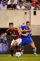 A. C. Milan defender Matias Silvestre (26) and Chelsea F. C. forward Fernando Torres (9). Chelsea F. C. defeated A. C. Milan 2-0 during round two of the 2013 Guinness International Champions Cup at MetLife Stadium in East Rutherford, NJ, on August 04, 2013.