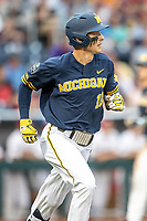 Michigan Wolverines third baseman Blake Nelson (10) runs to first base during Game 6 of the NCAA College World Series against the Florida State Seminoles on June 17, 2019 at TD Ameritrade Park in Omaha, Nebraska. Michigan defeated Florida State 2-0. (Andrew Woolley/Four Seam Images)