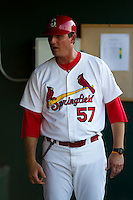 Manager Ron Warner (57) of the Springfield Cardinals in the dugout during a game against the Tulsa Drillers at Hammons Field on July 18, 2011 in Springfield, Missouri. (David Welker / Four Seam Images)