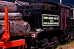 Antique train locomotive and log car displayed in Cowichan, British Columbia railway museum celbrating Vancouver Island heritage of forestry and logging, not to mention railroads.