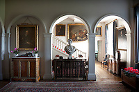 Arches frame a classicaly styled bust on display in an upstairs landing and hallway. A portrait of Thomas Wentworth, Earl of Strafford.K.G hangs on the left