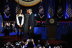 President Barack Obama joined on stage by his daughter Malia and First Lady Michelle Obama after he gave his farewell address to a crowd of thousands and the nation during his farewell address at McCormick Place in Chicago, Illinois on January 10, 2017.