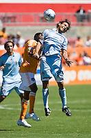Colorado Rapids midfielder Pablo Mastroeni (25) and Houston Dynamo midfielder Ricardo Clark (13) go up for the header.  Houston Dynamo defeated Colorado Rapids 1-0 at Robertson Stadium in Houston, TX on April 19, 2009.