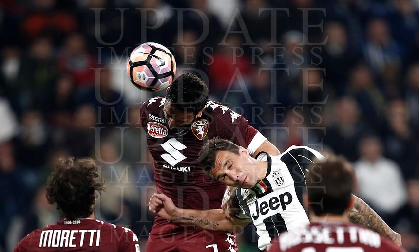 Calcio, Serie A: Torino, Juventus Stadium, 6 maggio 2017. <br /> Torino' Cristian Molinaro (l) in action with Mario Mandzukic  (r) during the Italian Serie A football match between Juventus and Torino at Torino's Juventus stadium, May 6, 2017.<br /> UPDATE IMAGES PRESS/Isabella Bonotto