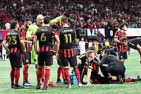 ATLANTA, GA - MARCH 07: ATLANTA, GA - MARCH 07: Atlanta United defender Laurence Wyke receives atten to  lion from the medical staff during the match against FC Cincinnati, which Atlanta won, 2-1, in front of a crowd of 69,301 at Mercedes-Benz Stadium during a game between FC Cincinnati and Atlanta United FC at Mercedes-Benz Stadium on March 07, 2020 in Atlanta, Georgia.