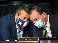 United States Senator Ted Cruz (Republican of Texas), left, and US Senator Mike Lee (Republican of Utah) confer as the US Senate Judiciary committee continues its hearing on the confirmation of Judge Amy Coney Barrett to the Supreme Court, in Washington, DC on October 15, 2020.<br /> Credit: Bill O'Leary / Pool via CNP /MediaPunch