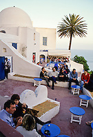 Tunisia, Sidi Bou Said.  Tunisians Relax in the Late Afternoon at the Cafe Sidi Sha'ban (French: Chebaane), a Popular Coffee House.