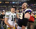Green Bay Packers quarterback Aaron Rodgers and Minnesota Vikings defensive end Jared Allen share a laugh following the Packers 31-3 win at the Hubert H. Humphrey Metrodome in Minneapolis, Minn. on Nov. 21, 2010.