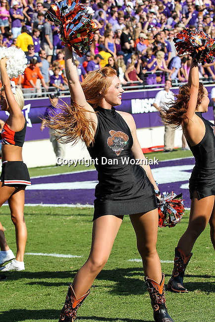 Oklahoma State Cowboys cheerleaders in action during the game between the OSU Cowboys and the TCU Horned Frogs at the Amon G. Carter Stadium in Fort Worth, Texas. TCU defeated OSU 42 to 9.