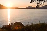 Couple, sea kayak camping, Strawberry Island, San Juan Islands, Puget Sound, Salish Sea, Washington State, U.S.A., Washington State Department of Natural Resources, Cypress Island Natural Resources Conservation Area,
