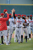 Richmond Flying Squirrels Heliot Ramos (18) high fives pitcher Sean Hjelle after an Eastern League game against the Erie SeaWolves on August 28, 2019 at UPMC Park in Erie, Pennsylvania.  Richmond defeated Erie 6-4 in the first game of a doubleheader.  (Mike Janes/Four Seam Images)