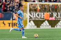 FOXBOROUGH, MA - SEPTEMBER 29: Jesus Medina #19 of New York City FC dribbles during a game between New York City FC and New England Revolution at Gillette Stadium on September 29, 2019 in Foxborough, Massachusetts.