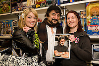 Sarah Bowden (left) of Forest Fields and Lucy Horan of the Meadows pose with Horror legend Tom Savini at his visit to The Monster Store in Nottingham