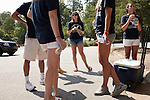 "August 20, 2011. Chapel Hill, NC.. Brooke Wolford, center, a student volunteer, waits in a parking lot before heading out to spread awareness of the American Eagle brand by helping incoming students with their stuff and giving away coupons on move in day. The event was organized by student "" brand ambassadors"" employed by the company.. Many companies have increased their efforts to reach the youth market by employing popular college students to raise the awareness of the brand by peer to peer marketing on campus' around the country."
