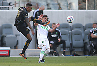 LOS ANGELES, CA - APRIL 17: Mark-Anthony Kaye #14 of LAFC during a game between Austin FC and Los Angeles FC at Banc of California Stadium on April 17, 2021 in Los Angeles, California.