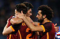 Calcio, Serie A: Roma vs Sampdoria. Roma, stadio Olimpico, 7 febbraio 2016.<br /> Roma's Diego Perotti, left, celebrates with teammates Stephan El Shaarawy, center, and Mohamed Salah, after scoring during the Italian Serie A football match between Roma and Sampdoria at Rome's Olympic stadium, 7 January 2016.<br /> UPDATE IMAGES PRESS/Riccardo De Luca