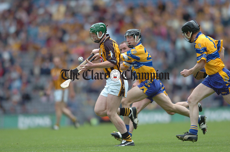 Henry Shefflin of Kilkenny is chased by Clare's Gerry Quinn. Photograph by John Kelly.