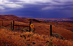 Lightning strikes in distance as a storm appoaches over the Powder River Valley between the towns of Halfway and Richland along Highway 86 on the Hells Canyon Scenic Byaway
