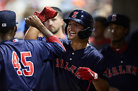 Nick Yorke (3) of the Salem Red Sox celebrates with teammate Miguel Suero (45) after scoring a run during the game against the Kannapolis Cannon Ballers at Atrium Health Ballpark on July 30, 2021 in Kannapolis, North Carolina. (Brian Westerholt/Four Seam Images)