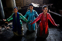 Senior Kartini Emergency School students, from left to right, 13 year old Dharma Uripa, 15 year old Sundarsih Ropindi and 14 year old Sepiani Wulandiri, have set up a traditional Betawinese Dance group. The group is financially supported by the 'Twin Teachers' who have encouraged the dance group to rehearse after school. They are available for hire and can earn decent money performing. Since the early 1990s, twin sisters Sri Rosyati (known as Rossy) and Sri Irianingsih (known as Rian) have used their family inheritance to set up and run 64 schools in different parts of Indonesia, providing primary education combined with practical skills to some of the country's most deprived children. .