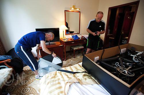 08 SEP 2011 - BEIJING, CHN - Iain Dawson (left) prepares his tandem with guide Liam Gentry at their hotel before the ITU World Paratriathlon Championships (PHOTO (C) NIGEL FARROW)