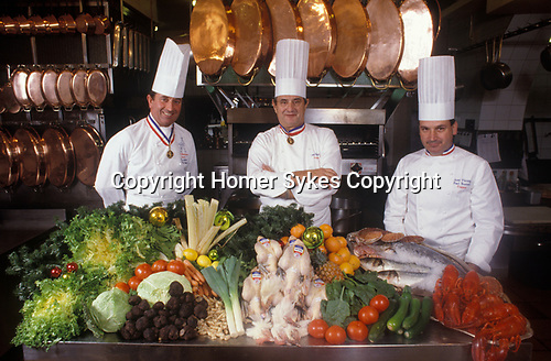 Paul Bocuse in his restaurant with chefs 1980s Lyon France 1980s