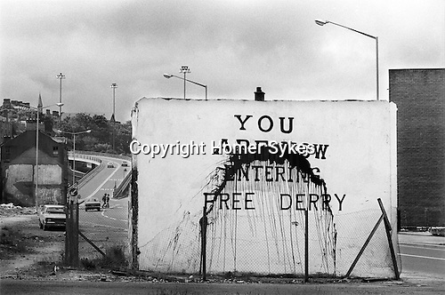 Derry Northern Ireland Londonderry. 1979. You Are Now Entering Free Derry wall mural. Know as Free Derry Corner, situated at the junction of Fahan Street & Rossville Street.