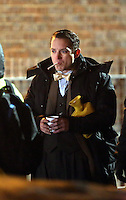 Pictured: Elijah Wood smokes a cigarette, has a hot drink keeps hold of his hot water bottle. Tuesday 11 February 2014<br />