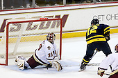 Brandon Brodhag (Merrimack - 12) puts the puck past Parker Milner (BC - 35) making it 3-2 giving Merrimack their first and only lead of the game. - The Boston College Eagles defeated the Merrimack College Warriors 4-3 on Friday, October 30, 2009, at Conte Forum in Chestnut Hill, Massachusetts.