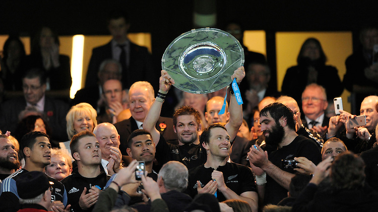 Richie McCaw of New Zealand lifts the Hillary Shield after winning the QBE International match between England and New Zealand at Twickenham Stadium on Saturday 8th November 2014 (Photo by Rob Munro)