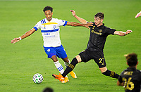 LOS ANGELES, CA - SEPTEMBER 02: Tristan Blackmon #27 of LAFC and Danny Hoesen #9 of the San Jose Earthquakes battle for a loose ball during a game between San Jose Earthquakes and Los Angeles FC at Banc of California stadium on September 02, 2020 in Los Angeles, California.