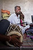 66-year-old Manganiyar artist, Lakha Khan sings and plays the Sarangi while his eldest son, Dane Khan (left) accompanies him with Dholak in their house in Raneri village of Jodhpur district in Rajasthan, India. Photo: Sanjit Das/Panos
