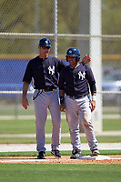New York Yankees coach Pat Osborne (left) and Jerry Seitz (49) during a minor league Spring Training game against the Toronto Blue Jays on March 22, 2016 at Englebert Complex in Dunedin, Florida.  (Mike Janes/Four Seam Images)