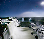Iguazu Falls by moonlight (also Iguazú Falls, Iguassu Falls or Iguaçu Falls) on the Iguasu River, Brazil / Argentina border. Photographed from the Brazilian side of the Falls. State of Paraná, Brasil.