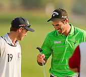 Spain's Alvaro Quiros and his caddie Michael Hough look at the Odyssey putter he used to hole the huge winning putt to become 2011 DWC Champion: The 2011 Dubai World Championships was played over the Earth Course, at Jumeirah Golf Estates, Dubai from 8th to 11th December 2011; Picture Stuart Adams, 11th December 2011