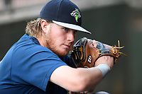 First baseman Dash Winningham (34) of the Columbia Fireflies pauses before a game against the Greenville Drive on Thursday, June 15, 2017, at Fluor Field at the West End in Greenville, South Carolina. Columbia won, 7-2. (Tom Priddy/Four Seam Images)
