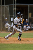 AZL Padres 1 shortstop Reinaldo Ilarraza (1) follows through on his swing during an Arizona League game against the AZL Padres 2 at Peoria Sports Complex on July 14, 2018 in Peoria, Arizona. The AZL Padres 1 defeated the AZL Padres 2 4-0. (Zachary Lucy/Four Seam Images)