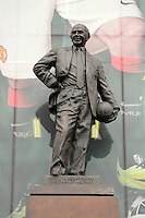 Pictured: The statue of Sir Matt Busby infront of a banner with a line-up of Manchester United players outside the Old Trafford. Saturday 16 August 2014<br /> Re: Premier League Manchester United v Swansea City FC at the Old Trafford, Manchester, UK.