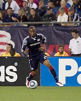 New England Revolution defender Darrius Barnes (25) dribbles. The New England Revolution defeated Houston Dynamo, 1-0, at Gillette Stadium on August 14, 2010.