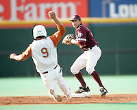 Texas A&M SS Jose Duran turns a double play in the 1st inning against Texas on May 16th, 2008 in Austin Texas. Photo by Andrew Woolley / Four Seam images.