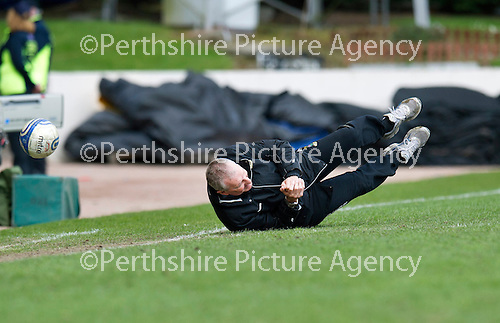 St Johnstone v Inverness Caley Thistle.....27.04.13      SPL.Terry Butcher trips and goes flying at full time.Picture by Graeme Hart..Copyright Perthshire Picture Agency.Tel: 01738 623350  Mobile: 07990 594431
