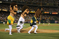 OAKLAND, CA - OCTOBER 4:  Dennis Eckersley, Rollie Fingers, and Rickey Henderson of the Oakland Athletics run in the Hall of Fame Race during the game against the Detroit Tigers during Game 1 of the ALDS American League Division Series at O.co Coliseum on October 4, 2013 in Oakland, California. Photo by Brad Mangin