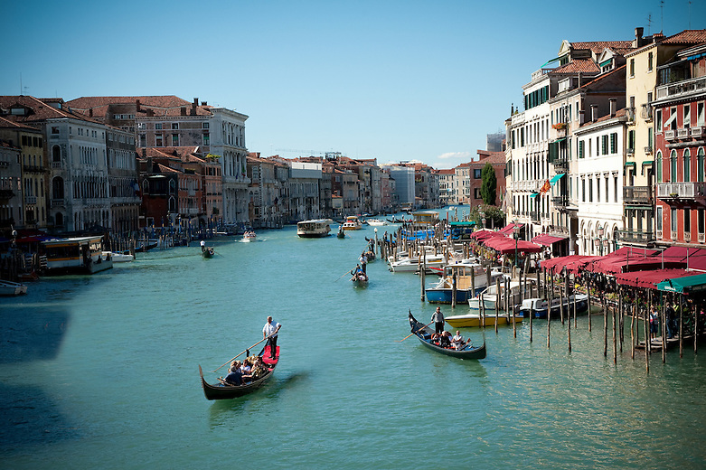 A former river bed, the Canal Grande gently flows through Venice forming an inverted 's'. Walkable waterfronts offer extraordinary views over this breathtaking water promenade. Gondoliers can be heard singing Opera along the canal.  Boats must respect a very strict speed limit (5 km/hour) meant to prevent their wake from endangering the fragile foundations of the buildings.