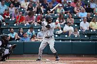 Fabricio Macias (25) of the Greensboro Grasshoppers at bat against the Winston-Salem Dash at Truist Stadium on June 19, 2021 in Winston-Salem, North Carolina. (Brian Westerholt/Four Seam Images)