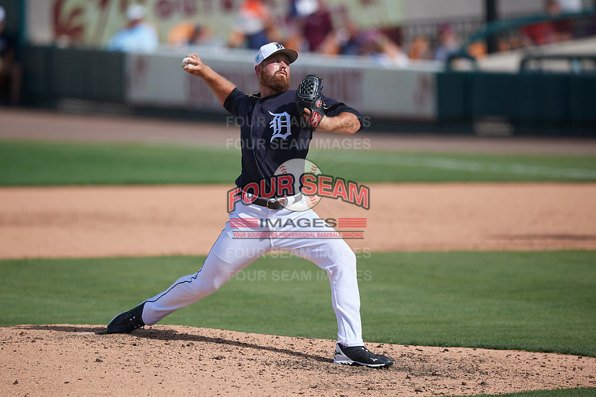 Detroit Tigers relief pitcher Buck Farmer (45) delivers a pitch during a Grapefruit League Spring Training game against the Atlanta Braves on March 2, 2019 at Publix Field at Joker Marchant Stadium in Lakeland, Florida.  Tigers defeated the Braves 7-4.  (Mike Janes/Four Seam Images)