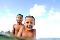 Two boys playing in the water. Over under water shot. Multicultural.