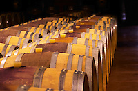 "The barrel aging cellars with rows of oak barrels. All are ""painted"" red in the middle with red wine to make them look more esthetic.  Domaine Pierre Gaillard, Malleval, Ardeche, ardèche, France, Europe"